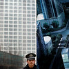 A security guard stands watch outside a buildings construction site in Beijing Thursday, March 18, 2010. The World Bank raised its China growth forecast this year to 9.5 percent from 9 percent on Wednesday but said Beijing needs to cool inflation and possible bubbles in real estate prices. (AP Photo/Andy Wong)