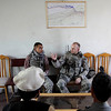 Lt. John Holland, right, of Katy, Texas with the 4th Brigade Special Troops Battalion, Military Police Platoon, talks with members of the Afghan National Police about security improvements Wednesday, March 17, 2010, in Nangarhar province of Afghanistan. (AP Photo/Julie Jacobson)