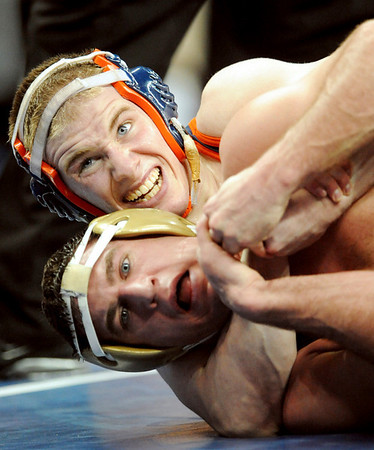 Northern Iowa's Tyson Reiner, bottom, tries to get free from Virginia's Dan Gonsor, during their match at the NCAA Wrestling Championships on Thursday March 18, 2010, in Omaha, Neb.(AP Photo/Dave Weaver)