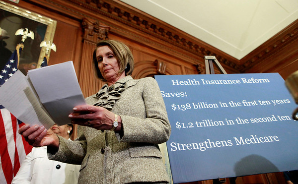 House Speaker Nancy Pelosi of California, looks over her notes during a news conference on healthcare on Capitol Hiil in Washington, Thursday, March 18, 2010.(AP Photo/Pablo Martinez Monsivais)
