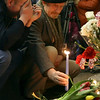 A man places a candle in memory of the subway blasts' victims at the Lubyanka Subway station, which was earlier hit by an explosion, Moscow, Monday, March 29, 2010.  Two explosions blasted Moscow's subway system Monday morning as it was jam-packed with rush-hour passengers, killing at least 37 people, emergency officials and news agencies said.(AP Photo)