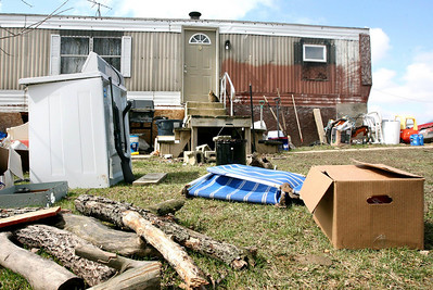 "A gun leaning against a washing machine is seen on the yard in front of a trailer on property belonging to David Brian Stone, the leader of Midwest Christian militia Hutaree, Monday March 29, 2010, the day after an FBI raid in Clayton, Mich. Nine suspects tied to a Midwest Christian militia that was preparing for the Antichrist were charged with conspiring to kill police officers, then attack a funeral using homemade bombs in the hopes of killing more law enforcement personnel, federal prosecutors said Monday. Members of the group, including its leader, David Brian Stone, also known as ""Captain Hutaree,"" were charged following FBI raids over the weekend on locations in Michigan, Ohio and Indiana. (AP Photo/Madalyn Ruggiero)"
