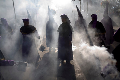 Christians burn incense during a Holy Week procession in Guatemala City, Monday, March 29, 2010. (AP Photo/Rodrigo Abd)