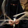 A Saudi woman works to demonstrate her craft as she makes a cane box, during the Saudi Travel and Tourism investment Market (STTIM) fair in Riyadh, Saudi Arabia, Monday, March 29, 2010. (AP Photo/Hassan Ammar)