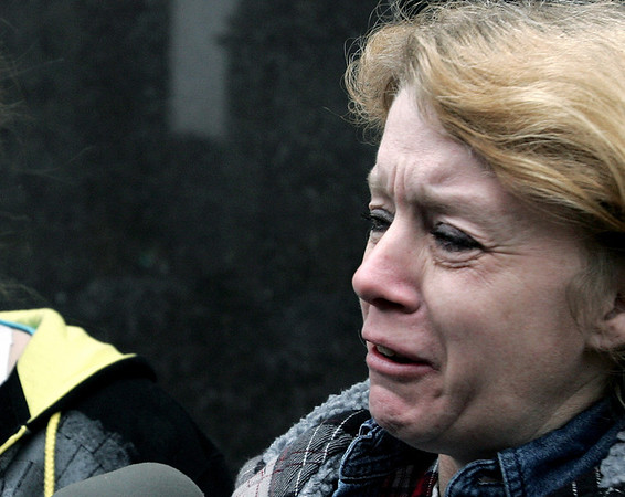 Donna Stone, David Brian Stone's ex-wife  cries as she talks to members of the media outside the Federal Courthouse on Monday, March 29, 2010 in Detroit. David Stone and David Stone Jr., Donna's son, were among several members of a Midwest Christian militia called Hutaree, who were charged with conspiring to kill police officers, then attack a funeral using homemade bombs in the hopes of killing more law enforcement personnel, federal prosecutors said Monday.  Donna Stone, told The Associated Press before the arraignments that her former husband was to blame for pulling her son into the Hutaree movement. She said David Brian Stone legally adopted her son, David Brian Stone Jr., who is among those indicted. (AP Photo/Jerry S. Mendoza)
