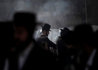 Ultra-Orthodox Jewish men burn leavened items in a final preparation before the Passover holiday, in Jerusalem, Monday, March 29, 2010. All leavened food, such as bread, is forbidden to Jews during the week-long Passover holiday commemorating the Israelites' departure from Egypt. (AP Photo/Tara Todras-Whitehill)