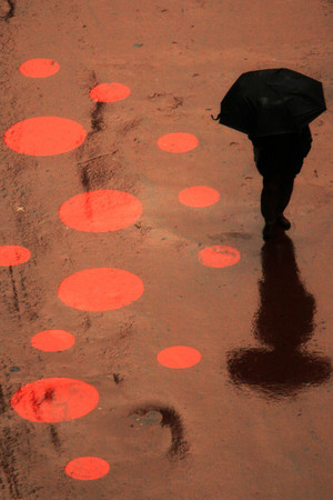 A pedestrian makes his way in New York's Times Square in the rain, Monday, March 29, 2010, in New York.  (AP Photo/Mary Altaffer)