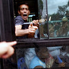 APTOPIX_Cuba_Opposition_Pro.JPG A man shouts from the inside of a bus carrying members of Ladies in White, a group of female dissidents, in Havana, Sunday, April 18, 2010. Cuban security agents denied the wives and mothers of jailed dissidents permission to hold their weekly march Sunday, setting off a standoff under the sun that ended with the women being led away by officials. (AP Photo/Javier Galeano)