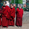 Exiled Tibetan Buddhist monks wear masks depicting Gendun Choekyi Nyima, the 11th Panchen Lama, behind bars to mark his 21st birthday in Dharmsala, India, Sunday, April 25, 2010. The boy and his family disappeared soon after he was named the reincarnation of the Panchen Lama in 1995 by the Dalai Lama, and have not been heard from since. Tibet's governor however says Gendun Choekyi Nyima is living a normal life with his family in the Himalayan region. (AP Photo/Ashwini Bhatia)