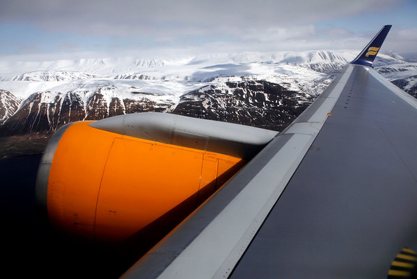 In this Saturday, April 24, 2010 photo, the wing of an Icelandair flight is seen as it leaves Akureyi Airport in Akureyi, Iceland en route to Glasgow.  For the first time since the April 14 eruption, Iceland's major international airport was closed after shifting winds blew the ash cloud toward the capital of Reykjavik, west of the Eyjafjallajokull volcano. Trans-Atlantic flights on Icelandair that usually stop in Iceland were being rerouted through Glasgow in Scotland. Akureyi Airport remained open with an afternoon flight to Glasgow. (AP Photo/Carolyn Kaster)