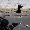 Israeli police officers take positions during clashes with Palestinian youths, not seen, in the east Jerusalem neighborhood of Silwan, Sunday, April 25, 2010. Palestinian protesters burned tires and garbage and threw rocks and two firebombs at Israeli police as three dozen ultranationalist Jews, carrying Israeli flags, marched on Sunday through the east Jerusalem neighborhood of Silwan to dramatize their claims to the eastern sector of the contested holy city. (AP Photo/Sebastian Scheiner)