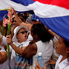 Laura Pollan, second left, leader of the Ladies in White, a group of female Cuban dissidents, is surrounded by government supporters after a Sunday mass in Havana, Sunday, 25, 2010. A small group of government supporters shouted down an even smaller contingent of wives and mothers of jailed opposition activists Sunday, preventing their traditional march for the third straight week. (AP Photo/Javier Galeano)