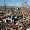 In this April 24, 2010 photo, Leslie Woods, of Satartia, Miss, salvages what he can from what is left of the family's utility building after a tornado hit in Satartia, Miss. Rescuers spread out Sunday to scour neighborhoods of splintered homes and twisted debris in Mississippi, a day after a devastating tornado sliced through the state and killed 10 people, including three children. (AP Photo/The Clarion Ledger, Vickie D. King)