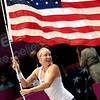 Bethanie Mattek-Sands, of the United States, leads her teammates around the court following a 6-3, 6-1 doubles win over Russia in their Fed Cup tennis doubles match in Birmingham, Ala., Sunday, April 25, 2010.  The US beat Russia 3-2. (AP Photo/Dave Martin)