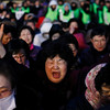 South Korean Christian women pray during an annual Easter service rally in front of the Seoul City Hall, South Korea, Sunday, April 4, 2010. About 10,000 Christians were demanding peace and a nuclear-free Korean peninsula. (AP Photo/Ahn Young-joon)