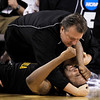 West Virginia head coach Bob Huggins consoles forward Da'Sean Butler after he was injured during the second half against Duke in a men's NCAA Final Four semifinal college basketball game Saturday, April 3, 2010, in Indianapolis. (AP Photo/Darron Cummings)