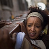 A Christian Ethiopian pilgrim holds a cross during Good Friday processions along Via Dolorosa, in Jerusalem's Old City, Friday, April 2, 2010. Christians are marking the solemn period of Easter. (AP Photo/Bernat Armangue)