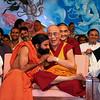 Yoga guru Baba Ramdev, left, sits with the Dalai Lama - the spiritual leader of the people of Tibet -  right, in Haridwar,  India, Saturday, April 3, 2010. (AP Photo)