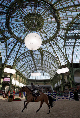 Helena Lundback of Sweden rides her horse Madick during the Saut Hermes jumping tournament at the Grand Palais in Paris, Saturday, April 3, 2010. (AP Photo/Christophe Ena)