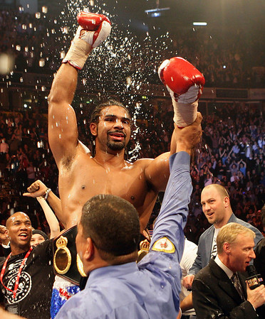 Britain's David Haye celebrates beating John Ruiz of the USA to retain the WBA Heavyweight World Championship boxing match at the MEN Arena in Manchester, England, Saturday, April 3, 2010. (AP Photo/Simon Dawson)