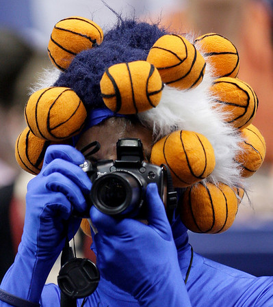 Connecticut fan Danny Karkowski takes a photo during the Wade trophy presentation at the NCAA Women's Final Four college basketball tournament Saturday, April 3, 2010, in San Antonio, Texas. (AP Photo/Eric Gay)