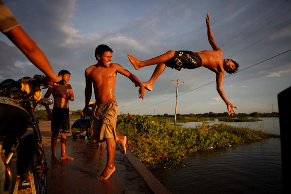 Youths play in a lagoon near the eastern Beni state capital of Trinidad, Bolivia, Saturday, April 3 , 2010.  Bolivia will hold governor and mayoral elections on Sunday. (AP Photo/Dado Galdieri)