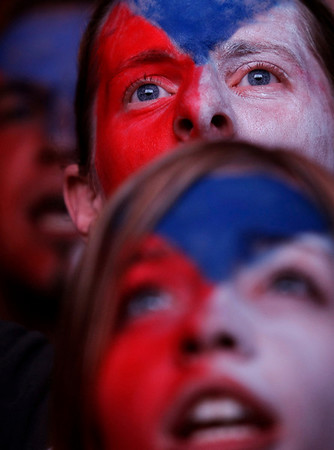Czech Republic's ice hockey fans react during the Ice Hockey World Championships finals in Germany between Czech Republic and Russia being displayed live at the Old Town square in Prague, Czech Republic, Sunday, May 23, 2010. Czech Republic won the match 2-1 and gained the gold medals. (AP Photo/Petr David Josek)