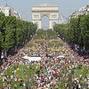 Visitors walk between planted fields on the Champs Elysees near the Arc de Triomphe monument in Paris, Sunday , May 23, 2010. Young French Farmers organize a two-day event called 'Nature Capitale' where they install the fields and forest of France in the French capital in Paris. (AP Photo/Jacques Brinon)
