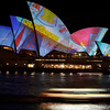 The Sydney Opera House is lit with vibrant colors during the launch of the annual Vivid festival in Sydney, Australia, Thursday, May 27, 2010.  Landmarks across the city will be illuminated, street performers and musicians will entertain during the month-long festival. (AP Photo/Rick Rycroft)