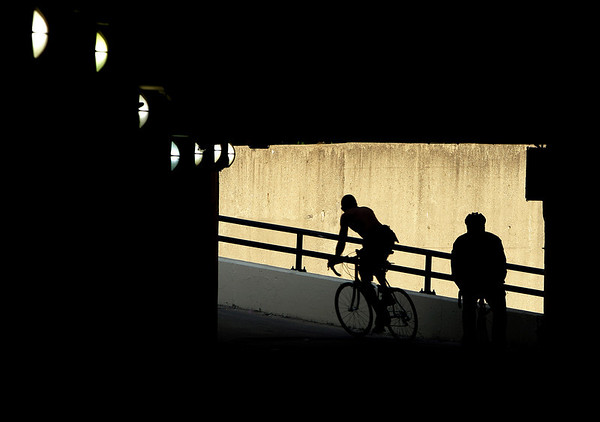 Early morning cyclists pedal through a tunnel under Lakeshore Drive into downtown Chicago Thursday, May 27, 2010. (AP Photo/Kiichiro Sato)