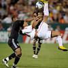 AC Milan's Ronaldinho, right, attempts an overhead kick as DC United's Julius James, left, defends during the second half of a friendly soccer game, Wednesday, May 26, 2010, in Washington. D.C. United won 3-2. (AP Photo/Nick Wass)