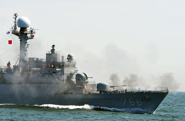 A South Korean patrol boat fires during a drill off the western coast town of Taean, South Korea, on Thursday May 27, 2010. A fleet of South Korean warships fired artillery and dropped anti-submarine bombs Thursday in a large-scale military exercise off the west coast despite North Korea's warnings that such drills will drive the peninsula to the brink of war. (AP Photo/Kim Jae-hwan, Pool)