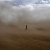An Afghan man walks during a dust storm in Kabul, Afghanistan, on Thursday, May 27, 2010. (AP Photo/Musadeq Sadeq)