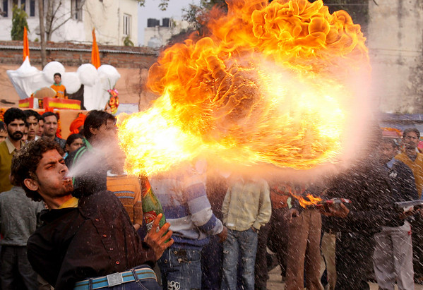 A fire eater participates in a procession ahead of Shivratri, in Jammu, India, Thursday, Feb. 11, 2010. Shivratri, a festival dedicated to the worship of Hindu God Shiva, will be marked across India Friday. (AP Photo/Channi Anand)