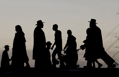 Ultra-orthodox Jews walk in Jerusalem, Thursday, Feb. 11, 2010. (AP Photo/Bernat Armangue)