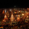 Devotees perform evening rituals on the banks of the River Ganges during the Kumbh Mela in Haridwar, India, Thursday, Feb. 11, 2010. Millions of people are expected to bathe in the river Friday, one of the 10 auspicious days of the monthslong festival, when devout Hindus believe a dip will cleanse them of their sins and free them from the cycle of life and rebirth. According to Hindu mythology Kumbh festival is celebrated in four places in India where drops of the nectar of life are said to have fallen during a tug of war between the gods and demons in ancient times(AP Photo/Rajesh Kumar Singh)