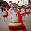 Chinese perform with traditional drums during a media preview of a temple fair in Beijing, China, Thursday, Feb. 11, 2010. (AP Photo/Vincent Thian)