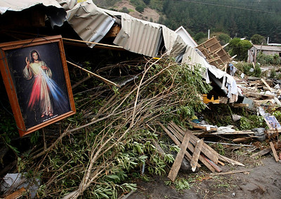 A painting of Jesus Christ hangs from a damaged house in Iloca, Chile, Monday, March 01, 2010. An 8.8-magnitude earthquake hit Chile early Saturday. (AP Photo/Fernando Vergara)