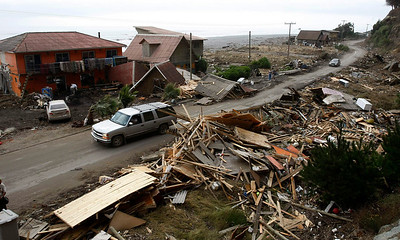 Damaged houses are seen in Iloca, Chile, Monday, March 01, 2010. (AP Photo/Fernando Vergara)