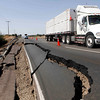 A truck passes a damaged way near San Rafael,134 miles south of Santiago, Chile on Saturday, Feb. 27, 2010.  (AP Photo/Aliosha Marquez)