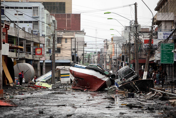 A boat lies marooned on a street in Talcahuano, Chile, Monday, March 1, 2010. (AP Photo/ Natacha Pisarenko)