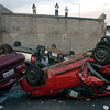 Vehicles that were driving along a highway that collapsed near Santiago are seen overturned  on the asphalt Saturday, Feb. 27, 2010 after a powerful earthquake struck central Chile early Saturday.(AP Photo/Carlos Espinoza)