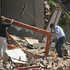 Men remove a door frame from earthquake debris in Concepcion, southern Chile, Saturday, Feb. 27, 2010. (AP Photo)