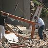 Men remove a door frame from earthquake debris in Concepcion, southern Chile, Saturday, Feb. 27, 2010. (AP Photo)