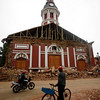 A resident looks at a destroyed church  in Constitucion, Chile, Monday, March 1, 2010, after an 8.8-magnitude earthquake struck central Chile early Saturday, Feb. 27. An 8.8-magnitude earthquake that struck central Chile early Saturday, Feb. 27,  killed at least 708 people and destroyed or badly damaged 500,000 homes. (AP Photo/ Roberto Candia)
