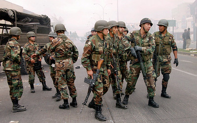 Chilean soldiers patrol the streets of  Concepcion, Chile, Monday, March 1, 2010. (AP Photo/Ricardo Pasten)