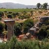 A collapsed bridge over the Claro river is seen near the town of Camarico, Chile. (AP Photo/Aliosha Marquez)