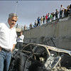Chile's President-elect Sebastian Pineira looks at an earthquake-damaged area in Concepcion, Chile, Saturday Feb. 27, 2010 after an 8.8-magnitude struck central Chile. (AP Photo)