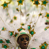 A member of Grande Rio samba school parades during carnival celebrations at the Sambadrome in Rio de Janeiro, early Tuesday, Feb. 16, 2010. (AP Photo/Silvia Izquierdo)