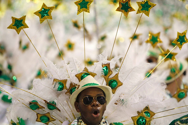 A member of Grande Rio samba school parades during carnival celebrations at the Sambadrome in Rio de Janeiro, early Tuesday, Feb. 16, 2010. (AP Photo/Silvia Izquierdo)